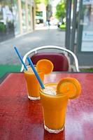 Two glasses of orange juice in a terrace. Madrid, Spain.