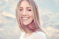 Smiling young adult woman portrait.