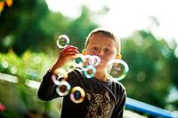 Child making Bubbles.
