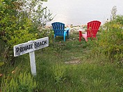 Colorful charis and private beach sign in Ephraim on Green Bay Door County Wisconsin.