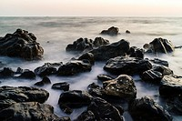 The view of many rocks at the seaside.