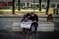 Two people sit and study a map in the precepts of Rouen Cathedral, Normandy, France.