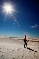 Alamogordo, New Mexico - A woman hiking in White Sands National Monument.