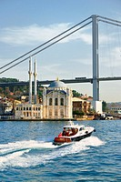 Ortakoy Mosque, Istanbul, Turkey, seen from the Bosphorus. Completed 1856. The First Bosphorus Bridge rises behind.