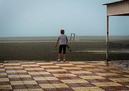 A woman back view in Playa Lisa beach, Alicante, Spain