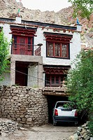 Car parked at a monks house. Hemis gompa. Indus valley, Ladakh (india).