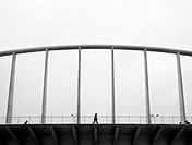 Man walking on Exposicio bridge made by Santiago Calatrava, Valencia, Spain.