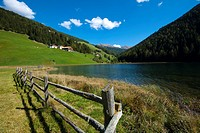 Durnholz or Valdurna, overlooking the lawns and the lake around the country, Sarentino, Sarntal valley, Trentino-Alto Adige (Südtirol), Italy
