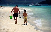 Young father with his little son walking at the seaside, Pointe d´Esny beach, Grand Port District, Southeastern coast of Mauritius, Mascarene, Mascare...