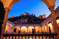 Alhambra seen at dusk from Archeological Museum, Granada, Spain.