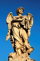 One of the angel statues known as the Angel with the Whips on Ponte Sant´Angelo, leading over the Tiber River to Vatican City.