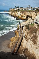 Clifftop houses, staircase to beach, Avila Beach State Park and town of Avila Beach, San Luis Obispo County, CA, USA.