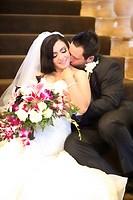 happy bride & groom sitting on stairs embracing