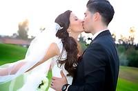bride & groom kissing after wedding