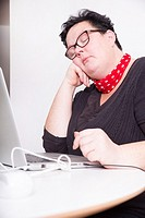Portrait of an overweight mature woman in the office. .