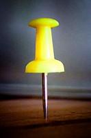 Yellow pushpin.