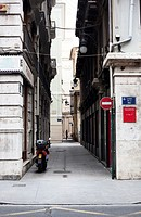 Alley with a motorcycle. Valencia, Spain.