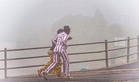 Running in the mist to catch a train. SOuth Africa.