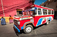 Bolivians Bus and women in street of La Paz. Bolivia. South America