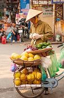 Peddler with a bike in Hanoi street. Hanoi. Vietnam