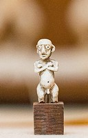 Egypt, Cairo, Egyptian Museum, very small statuette of a dwarf, in ivory.