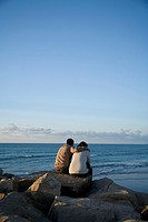 couple in love looking at the sea, Tangier, Marocco.