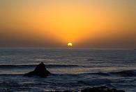 The sun sets on California´s Pacific Ocean at San Simeon.