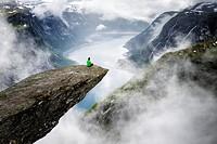 Norway, Hordaland, Hardangervidda region, Odda, Trolltunga (the troll´s tongue) 700 metres above lake Ringedalsvatnet.