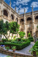 HDR image of the gardens in the central cloister of the Monastery of San Juan de los Reyes in Toledo Spain.