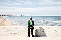 Man watching the Arenas beach and the sea. Valencia, Spain.