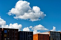 Clouds over container on a cargo ship, Baltic Sea, Europe.