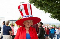 Everett, Washington: woman wears a patriotic top hat at the Donald J. Trump for President Rally at Xfinity Arena.