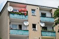 Balconies of social housing apartment building in Neukolln Berlin Germany.