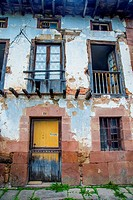 Facade of house in ruins. Carrejo, Cantabria, Spain.