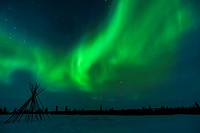 Nightsky and tentpoles lit up with aurora borealis, northern lights, wapusk national park, Manitoba, Canada.
