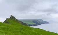 The island Mykines, seen from Mykinesholmur, part of the Faroe Islands in the North Atlantic. Europe, Northern Europe, Denmark, Faroe Islands.