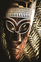 Still life Amazon jungle tribal mask on fern frond background. Ancient cultural warrior.