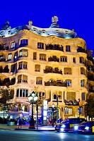 Mila House aka ´La Pedrera´ at night. Designed by architect Antoni Gaudi. Passeig de Gracia, Barcelona, Catalonia, Spain.