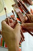 Woman kniting bolillos. Spain.