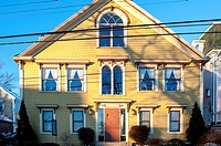 Example of home architecture showing many windows on the front of a house in Lunenburg, Nova Scotia, Canada.