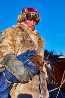 Mongolia, Bayan-Olgii province, Kazakh eagle hunter, Golden Eagle hunting in Altai mountains, winter season.
