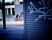 Young woman riding on a Bicing bicycle. Barcelona, Catalonia, Spain.