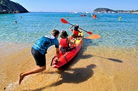 Kayak. Playa de Castell, Castle beach, Palamós town and municipality in the Mediterranean Costa Brava, located in the comarca of Baix Empordà, in the ...