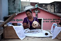 A woman cleans the bones of a deceased family member in the Mayan village of Pomuch, Hecelchakan, Campeche, Yucatán península, October 30, 2016, as pa...