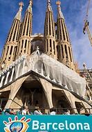 The Barcelona Bus Turistic outside La Sagrada Familia (the Church of the Holy Family) - Barcelona, Catalonia, Spain. The hop-on hop-off bus 'Barcelona...