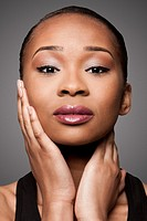 Beautiful face of black Asian blasian woman with cosmetics makeup, skincare concept.