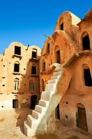 Ksar Ouled Soltane, a traditional Berber and Arab fortified adobe vaulted granary cellars, or ghorfas, situated on the edge of the northern Sahara in ...