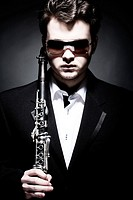 Portrait of Young Male Musician With Clarinet.