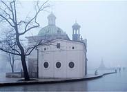 Main Market Square and St Adalbert church at foggy autumn morning, Krakow, Poland.