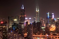 Shanghai, China - March 2, 2017: Shanghai skyline at night with the Shimao International Plaza and Tomorrow Square Towers on background.